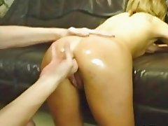 Blond slut fist fucked from behind by her dominant