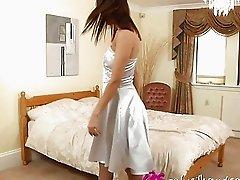 Gorgeous brunette teen in garter belt does awesome striptease in bedroom