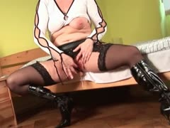 Lonely mature blonde fingering and toying her snatch in bed