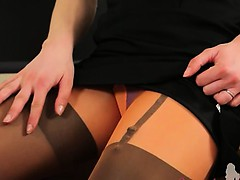 Sexy secretary teasing and posing