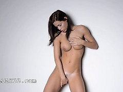 Busty woman dancing by the wall