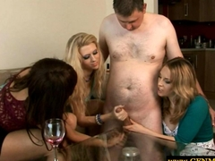 CFNM femdoms in group giving handjob to a pathetic sub