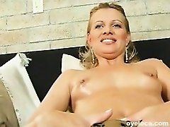 Hot blonde mami stripteases before riding a cock