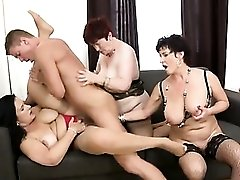 Three mature babes with great tits share a young dick