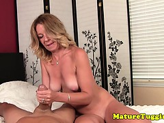 Classy milf stroking dick with both hands
