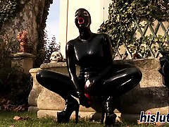 Horny bitch in latex pleasures her pussy