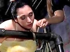 Brunette babe has freaky bondage sex in dungeon BDSM movie