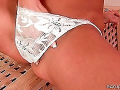 Sweet smiling solo girl does a lovely striptease