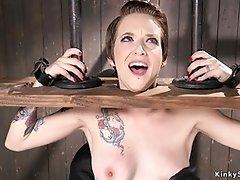 Brunette slut in wooden stock vibed