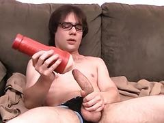 Young dude with glasses masturbates and uses a fleshlight