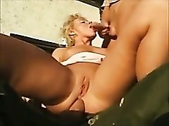 Two military guys fuck this hottie outdoors