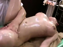 Stacked Asian beauty enjoys a hard dick on the massage table