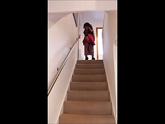 Up and down the stairs in red mini kilt