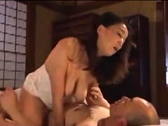 Big breasted Oriental milf stuffs her peach with hard meat