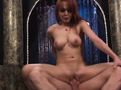 Exciting redhead stripper with big hooters enjoys hardcore sex action