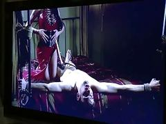 Slave is tied up by dominant tranny who fucks him