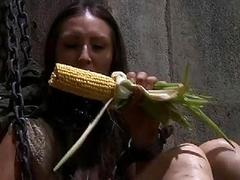 Bound woman eats a disgusting corn in sex dungeon BDSM