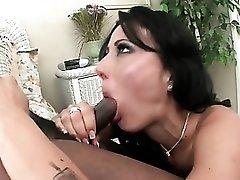 Milf beauty Zoey Holloway sucks black cock