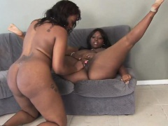 Chocolate skin sluts fuck each other with a strap on