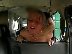 Scarlet flashes her tits inside the taxi